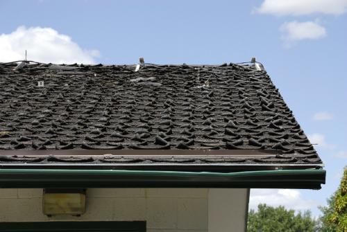 Asphalt roof in need of repair