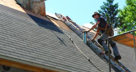 Man Installing Shingle Roof