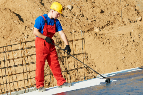 Applying Roofing Tar