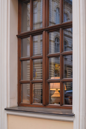 A double-hung wooden window frame will cost about $550 to $750 per window.  A small casement wooden window frame will cost about $650 to $850.